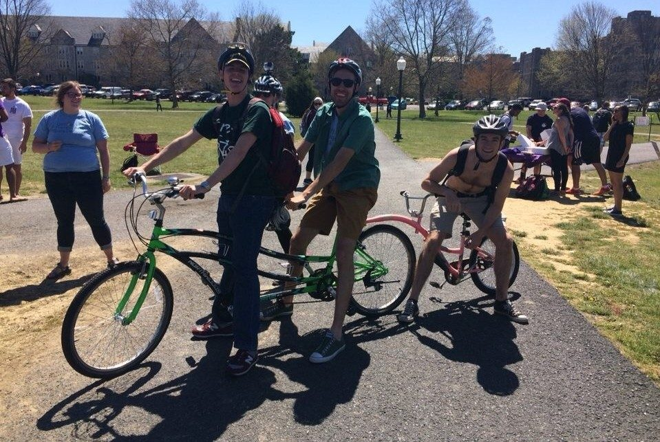Dyllan Taylor, Sustainability Intern, and two friends come in second on their tandem bike.